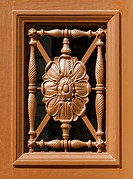 Carved wooden floral pattern decorative door window.