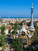 View of city of Barcelona from Parc Guell, Barcelona, Spain, Europe. Image taken from steps above the main entrance gate in front of one of the pavill...
