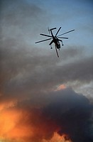 Helicopter fighting wildfire in Yosemite area, California, United States.