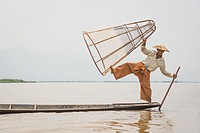 A fisherman poses for a photo. Inle Lake, Myanmar.