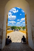 Two man sitting in the entrance of the San Antonio de Padua convent in Izamal, Yucatan, Mexico.