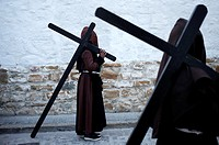 Hooded penitents carry crosses during Easter Week celebrations in Baeza, Jaen Province, Andalusia, Spain.
