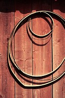 Rural building exterior. Metal circles hanging on wall.