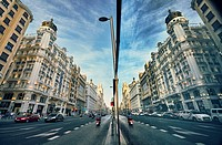 Reflection on a window in Gran Via Avenue. Madrid. Spain.