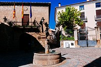 Stone fountain in front of village hall and tourist office, Rubielos de Mora, Teruel, Spain.