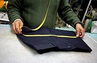 A tailor measures trousers in Sastrería Jimenez tailoring shop, Colonia Roma, Mexico City, Mexico.