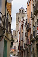 Old street and the tower of Santa Maria Church. Cervera, Lleida, Catalonia, Spain, Europe.