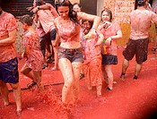 Young people enjoying the Tomatina, the world´s largest tomato fight, Tomatina, Buñol, Valencia, Spain