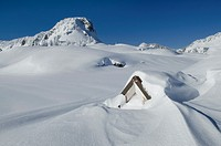 Stone structure nearly buried by winter snows, North Cascades washington.