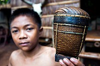 Tingkop basket held by Tagbanwal boy at Tagbanwa tribal village, Butterfly Garden, Santa Monica, Puerto Princesa, Philippines