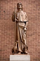 Statue of Saint Roch with injured leg and dog that brought him bread outside Saint Roch's Roman Catholic church Toronto Canada.