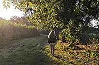 teenager by the Eure River, Eure-et-Loir department, Centre-Val de Loire region, France, Europe.