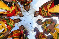 Nagaland tribesmen looking down with heads in a circle, Kisima Nagaland Hornbill festival, Kohima, Nagaland, India.