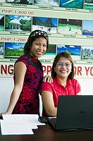 Travel agency staff members, Rizal Avenue, Puerto Princesa, Palawan, Philippines