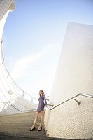 Model posing on the stairs of the City of Ates and Sciences, Valencia, Spain