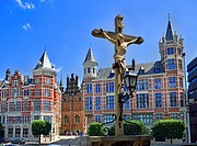 Antwerp, Belgium. View from Het steen - medieval fortress by the river. Stone Crucifix and buildings on Jordaenskaai.