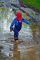 Young Boy Playing In Mud.