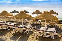 Straw umbrellas & Hammock, beach, Fuengirola. Malaga province Costa del Sol. Andalusia southern, Spain Europe.