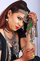 Young dancer in black dress and jewelry - Close-up.