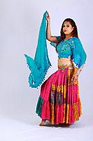 Young woman in Indian attire looking at camera.