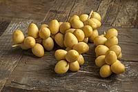 Bunch of fresh yellow dates on the table.