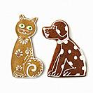 Cat and dog ginger cookies on white background.