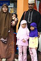 Malay family outside the Geylang market, Singapore.