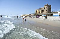 Mediterranean sea laps on to a sandy beach at Torre de la horadada in Spain.