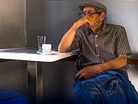 France, Nouvelle aquitaine, Gironde. Senior man in a Café at Bordeaux.