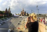 Blondie girl taking photo of Kremlin in Moscow. Russia.