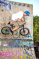 young adult riding on bmx at a skate park