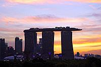 Silhouette of the Marina Bay Sands hotel at sunset against the yellow evening sky, Singapore, Southeast Asia.