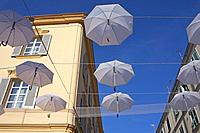 umbrellas hanging on the street of Sassari, Sardinia, Italy