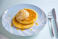 Pancakes with ice cream and honey.