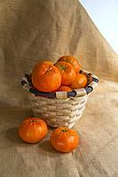 Basket full of mandarines. Still life.