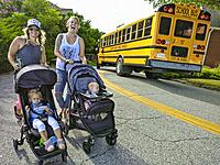 SOLOMONS ISLAND, MARYLAND Young mothers walking with prams and school bus.