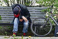 Sweden, Stockholm. Bicycles. Drunk man sleeping.