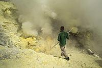 A miner extract sulfur rocks from the Kawah Ijen crater in East Java, Indonesia.