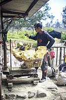 Miner weighting his baskets full of sulfur rocks from the Kawah Ijen Vocano, Java, Indonesia.