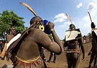 Bodi tribe fat men drinking milk during the Kael ceremony, Omo valley, Hana Mursi, Ethiopia.
