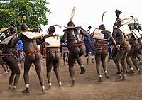 Bodi tribe fat men dancing during Kael ceremony, Omo valley, Hana Mursi, Ethiopia.