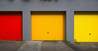 Three colorful garages in a row , Baden Württemberg , Germany.