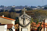 The view from a cemetery of a cross and the Peyne river valley, Pézenas , Herault, France.
