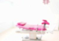 Defocused blur background of gynecological examination chair.