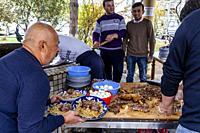 Men Cooking and Serving PLOV (The National Dish) At The Central Asian Plov Centre, Tashkent, Uzbekistan.
