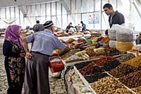 Local People Buying Dried Fruit and Nights At The Chorsu Bazaar, Tashkent, Uzbekistan.