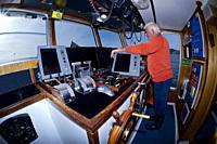Captain in ship´s bridge. Purse-seine fishing. Sardines (Sardina pilchardus). Horse mackerel (Trachurus trachurus). Mackerel (Scomber scombrus). Easte...