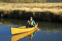 Canoeing on Millport Slough, Siletz Bay National Wildlife Refuge, Oregon.
