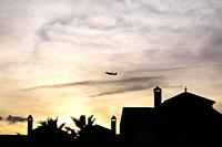 Airplane at sunset in Malaga, Spain, Europe.