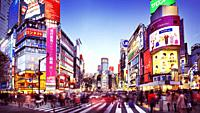 Rush hour at the Tokyo's busiest intersection, Shibuya station crossing, full of people and colors during sunset in Tokyo, Japan. 2014. Artistic motio...